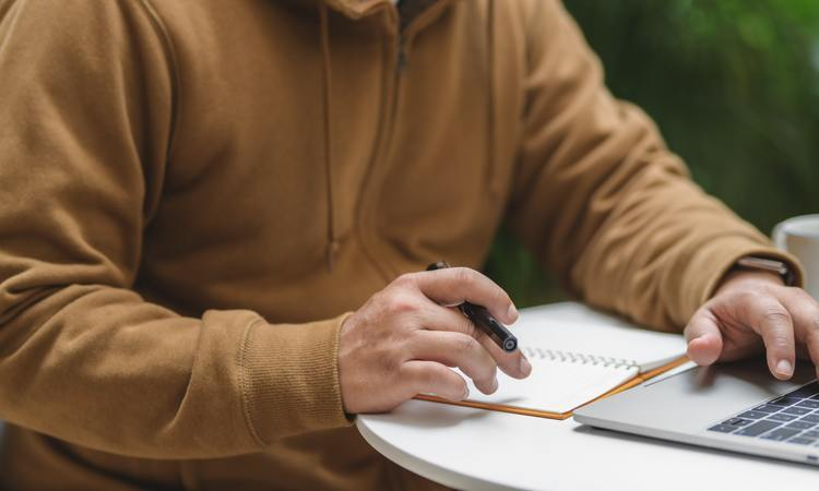 Person In Brown Long Sleeve Shirt Holding Black Pen 3787796